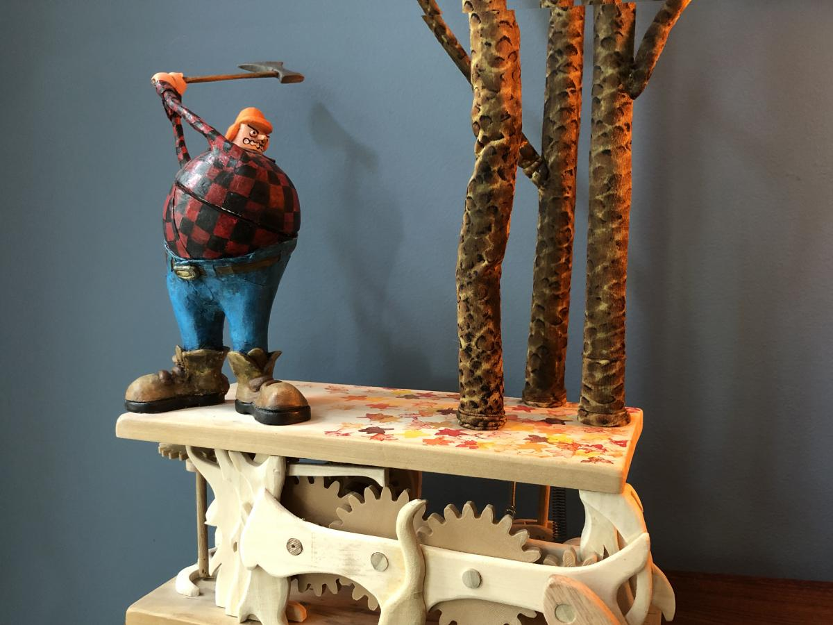 Artist Don Becker creates automatons after being laid off from his job during the pandemic. This mechanical sculpture features a woodcutter being thwarted by trees.