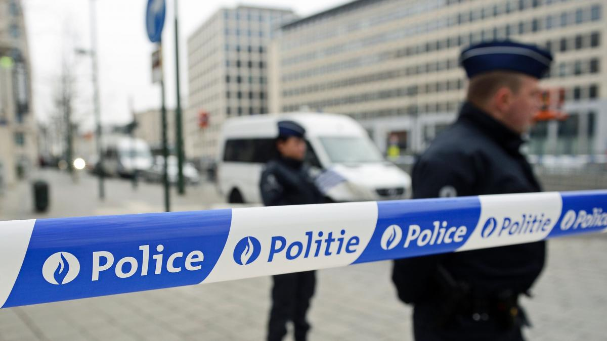 Police patrol outside the council chamber of Brussels on Thursday during ongoing investigations into the Paris and Brussels terrorist attacks. More than 30 people have been identified as being involved in a network behind the Paris attacks on Nov. 13, wit
