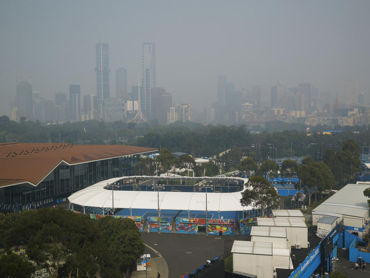 Smoke from bushfires shrouds the Melbourne city skyline. Hazardous breathing conditions prompted Australian Open officials to suspend practice sessions on Tuesday.
