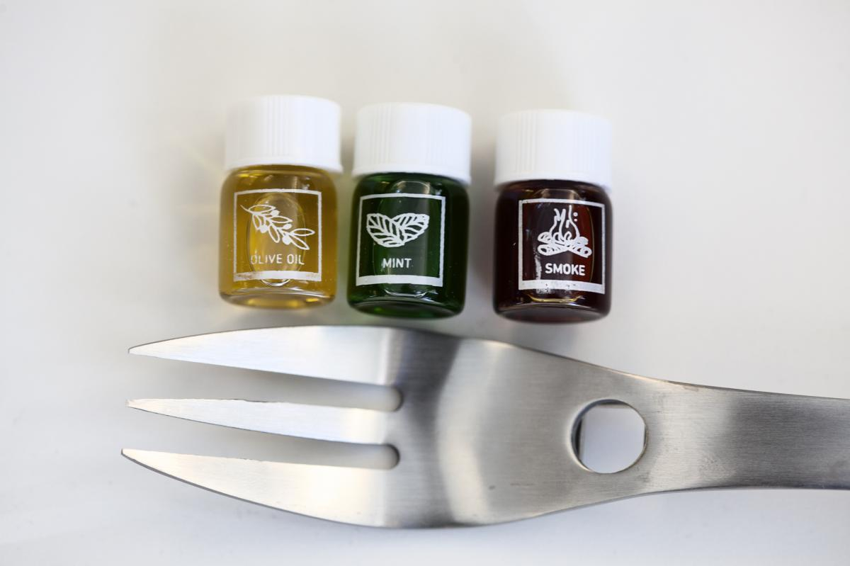 "The ""Aroma R-evolution"" kit comes with four forks and 21 vials full of aromas like olive oil, mint and smoke. You drop a dab of scented liquid onto the base of the fork, and the smell is supposed to subtly flavor the food you eat while using the utensil."