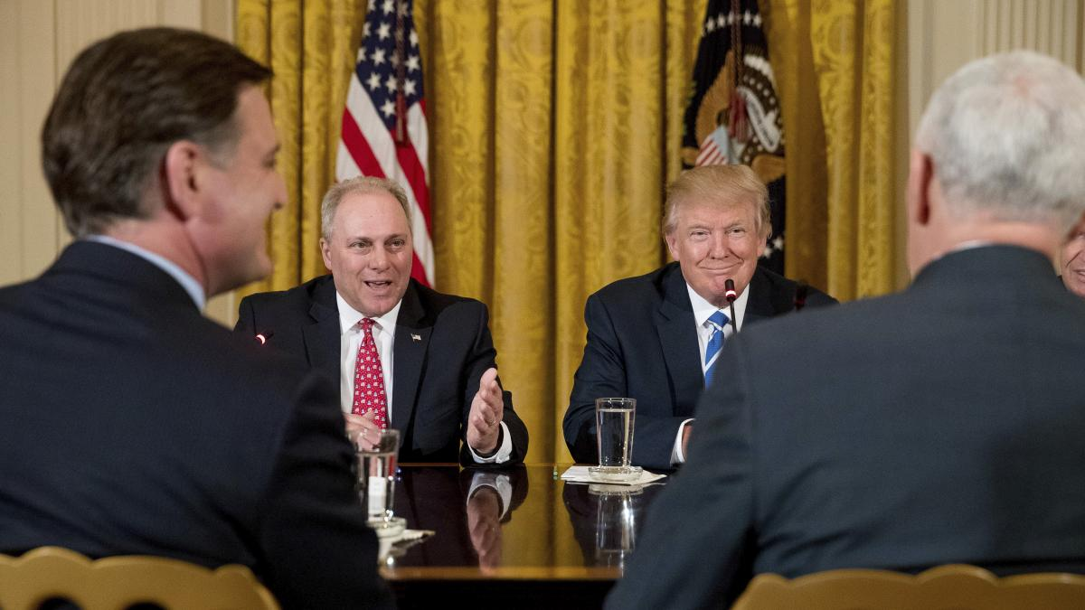 President Trump listens as House Majority Whip Steve Scalise of Louisiana speaks during a meeting with the Republican House whip team about the proposed health bill.