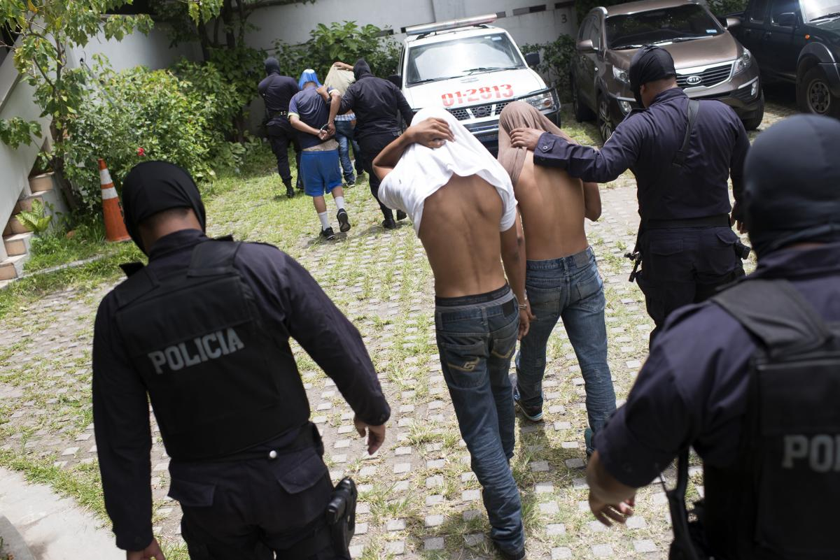 Police arrest gang members suspected of involvement in the shootings that killed eight bus drivers and one other transit worker in San Salvador last July.