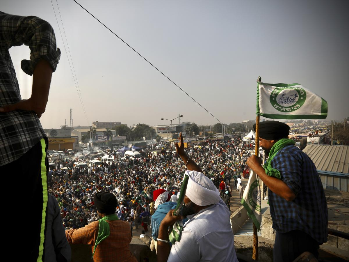 Farmers protest Thursday on a highway at the Delhi-Haryana state border in India. They have descended upon the borders of New Delhi to protest new farming laws that they say will open them to corporate exploitation.