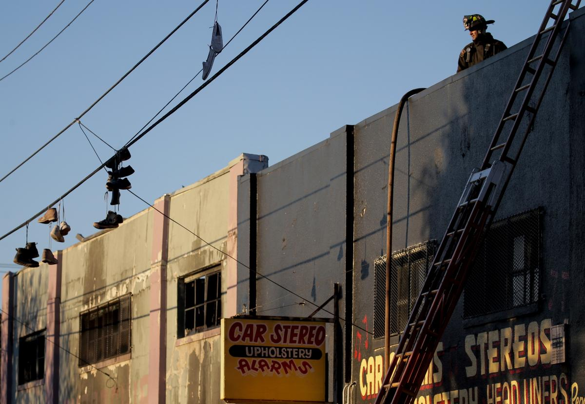On Saturday, firefighters investigate the scene of the overnight fire at the Ghost Ship warehouse in the Fruitvale neighborhood of Oakland.