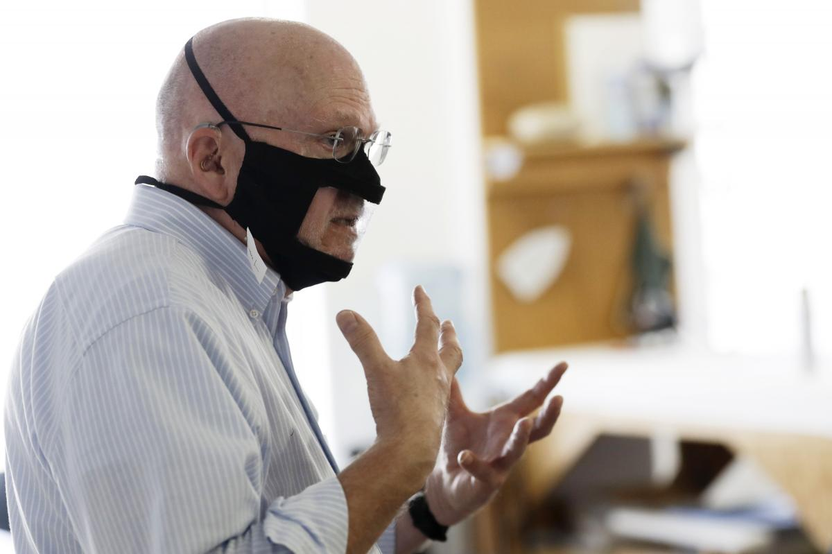 Michael Conley, who is deaf, models a mask that has a transparent panel in San Diego on June 3. Face coverings can make communication harder for people who rely on reading lips, and that has spurred a slew of startups and volunteers to make masks with pla