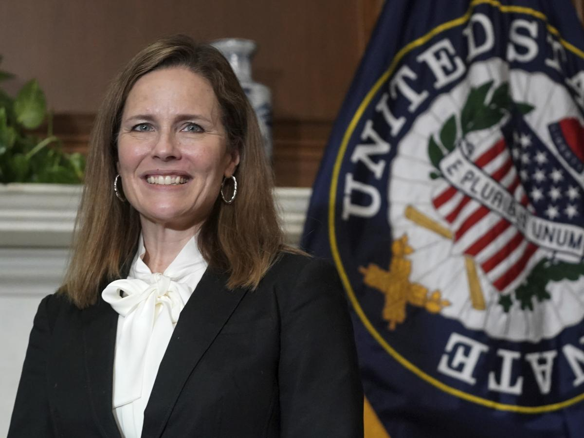 Judge Amy Coney Barrett, President Trump's nominee for the U.S. Supreme Court, meets with legislators last week on Capitol Hill.