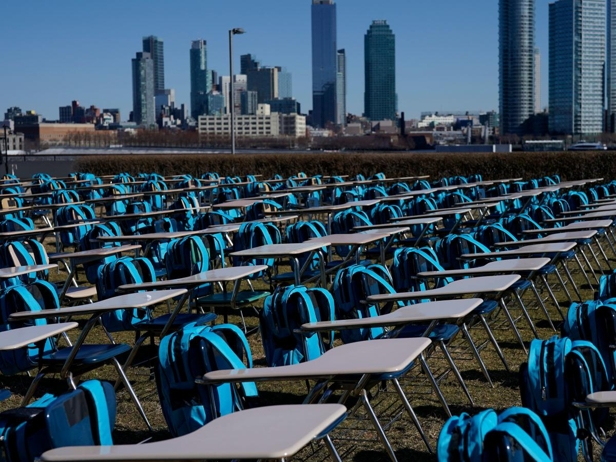 """School desks make up an exhibit called """"Pandemic Classroom"""" at the United Nations in New York City. Each of the 168 seats represents 1 million children living in countries where schools have been entirely closed almost a year."""