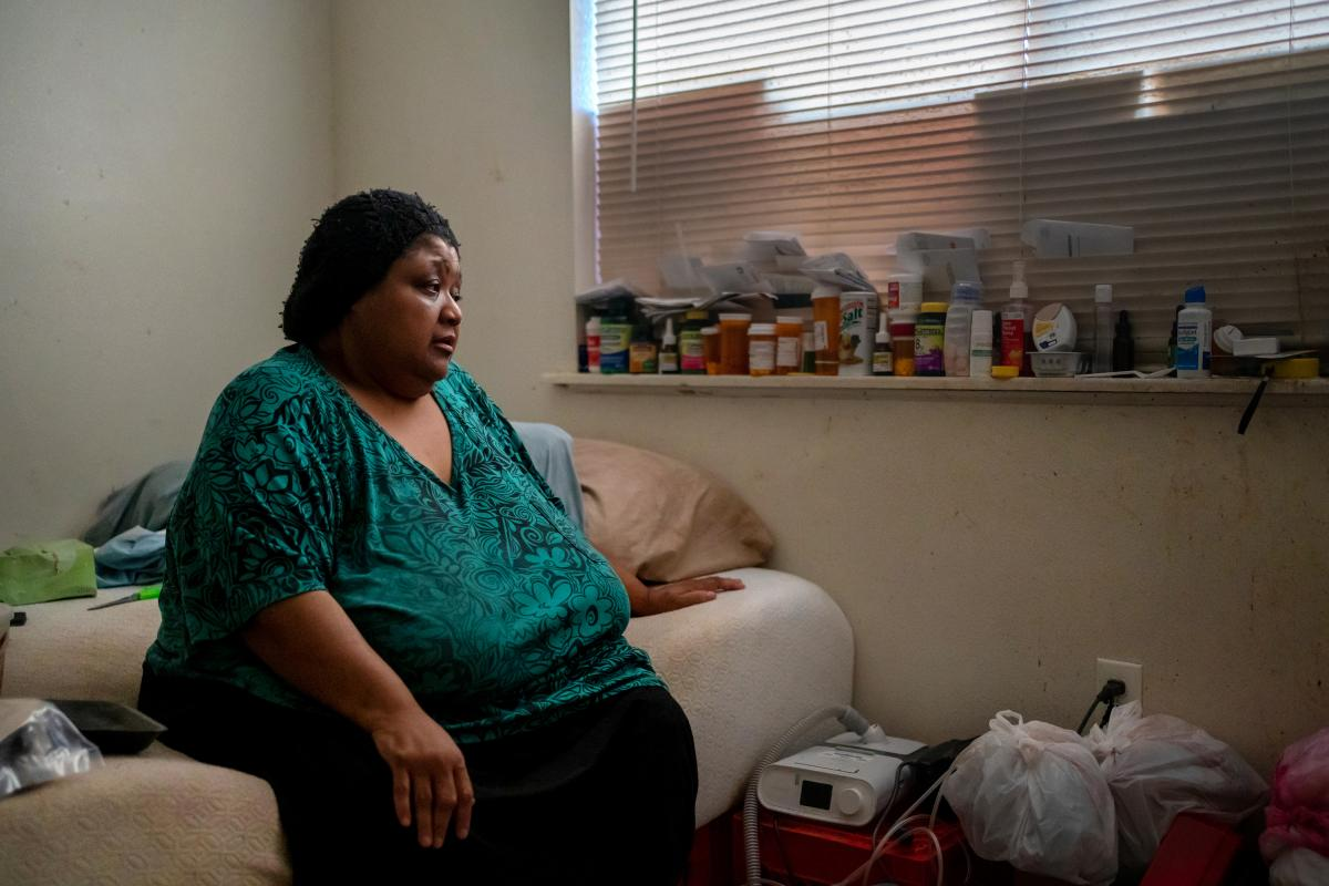 Wilma Banks, who lives in the neighborhood of New Orleans East, sits on her bed next to her nebulizer and CPAP machine. In the aftermath of Hurricane Ida, when much of New Orleans was left without power, she wasn't able to power up the medical devices and