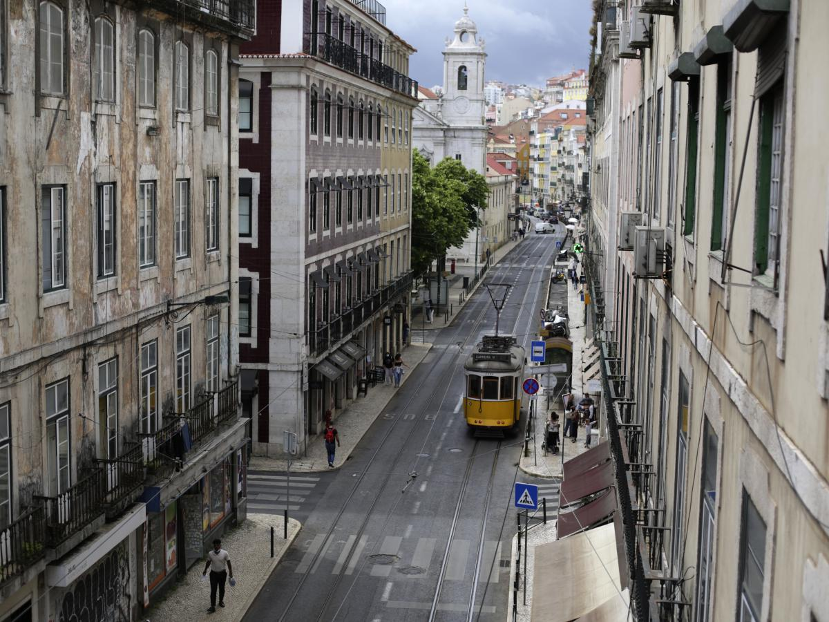 A tram drives through an empty downtown Lisbon, Portugal, on Friday. Portuguese authorities banned all weekend travel in and out of the capital to cut down on any further spread of the coronavirus to other parts of the country.