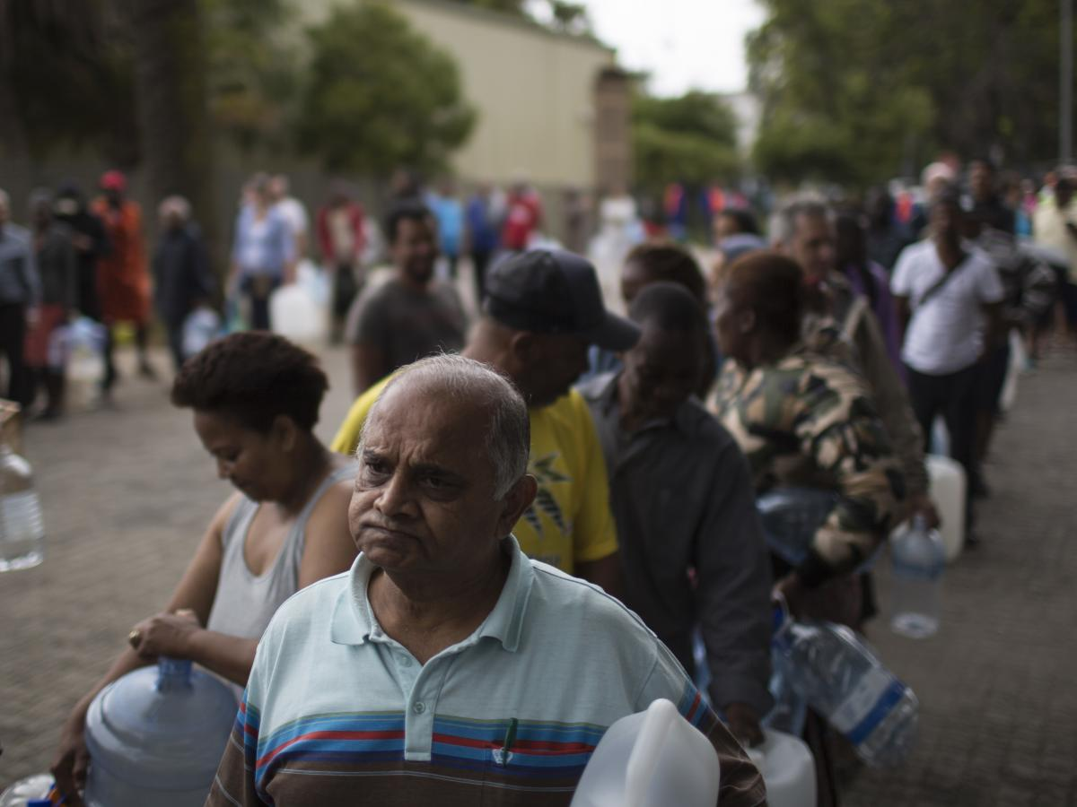 Residents wait to fill containers at a source for natural spring water in Cape Town, South Africa.