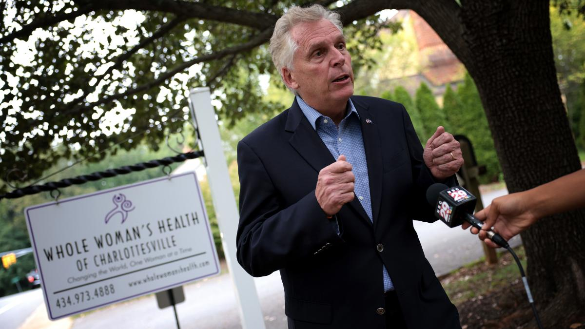 Former Virginia Gov. Terry McAuliffe, a Democrat running for a second term, answers questions from the media after touring Whole Woman's Health of Charlottesville on Sept. 9. He's working to rally voters in response to Texas' restrictive new abortion law.