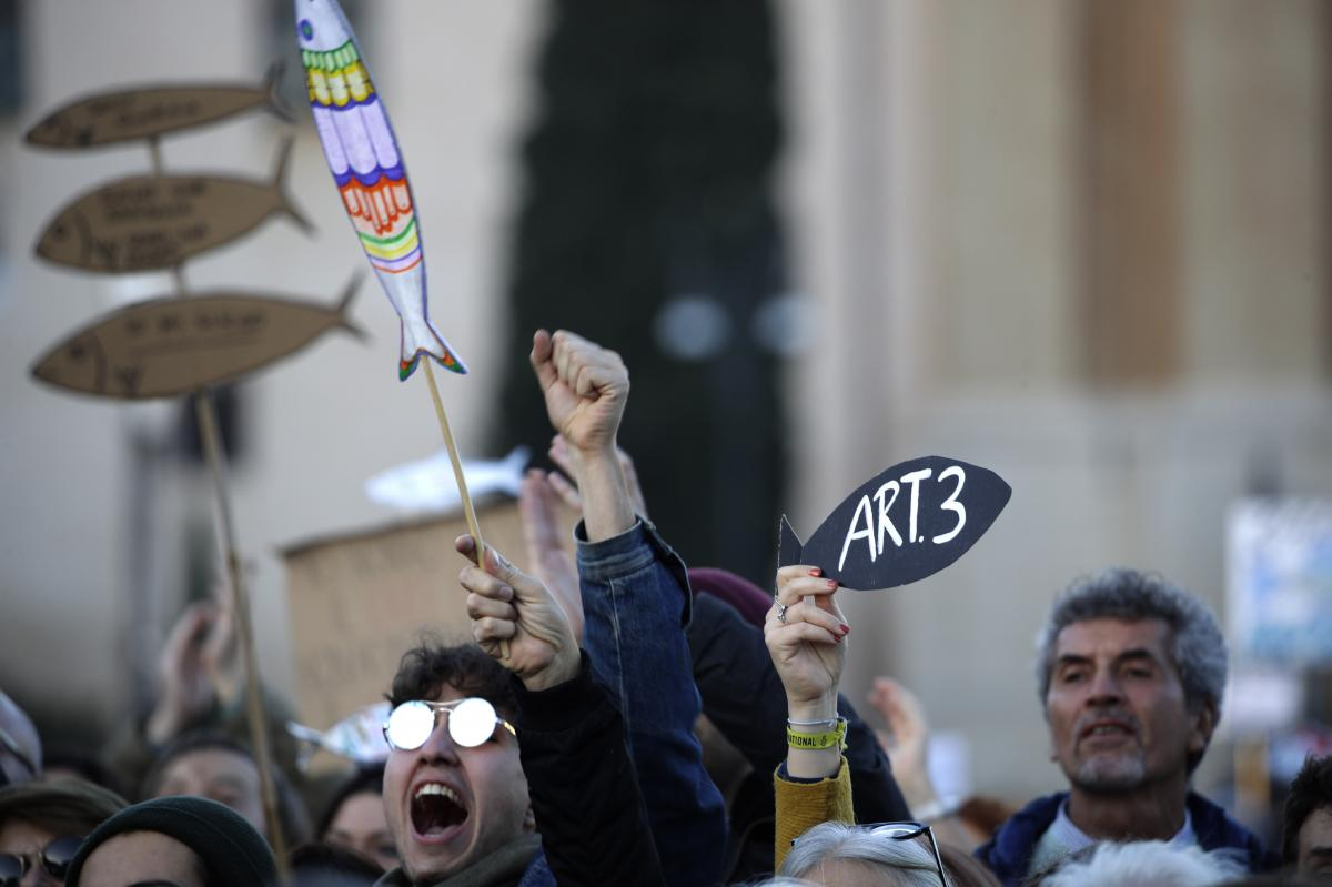 "Italians gather in St. John Lateran Square in Rome for a demonstration of the ""Sardines,"" a grassroots movement against right-wing populism, on Saturday."