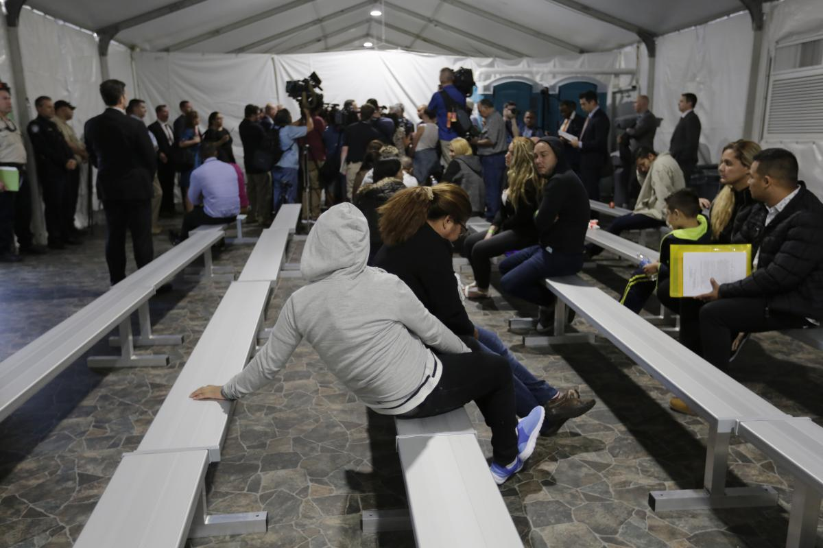 Migrants applying for asylum in the United States go through a processing area at a new tent courtroom at the Migration Protection Protocols Immigration Hearing Facility in Laredo, Texas, in September.