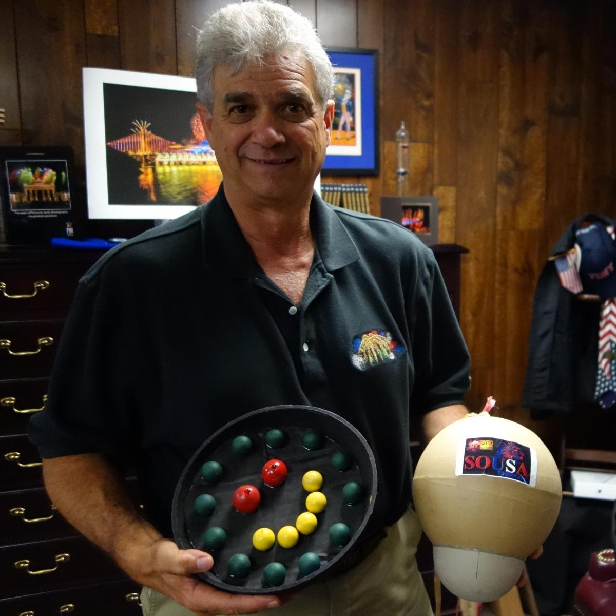 Jim Souza, president of Pyro Spectaculars, poses with samples of some of the fireworks he's planning for this year's Macy's show.