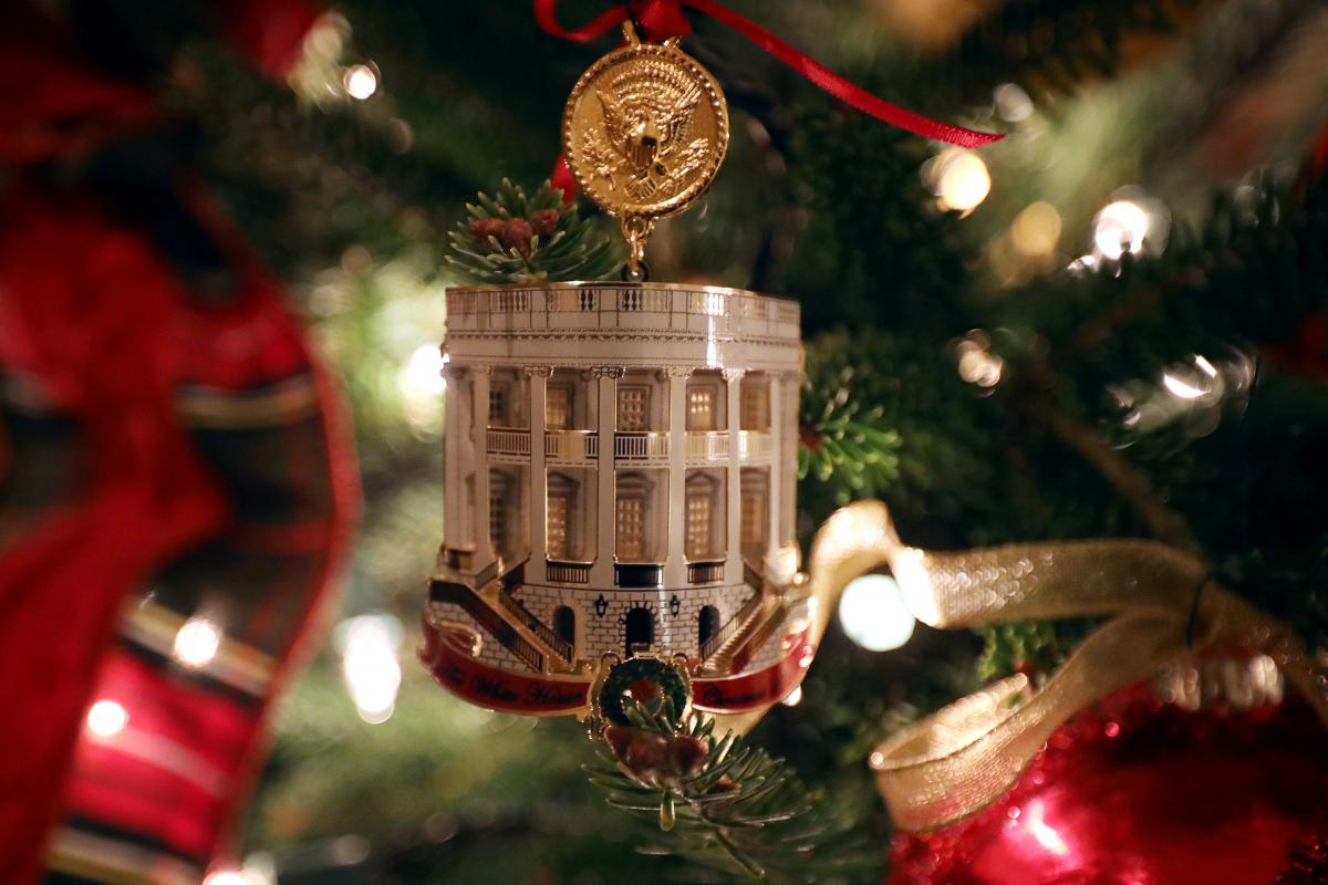 The White House Historical Association's official 2018 Christmas ornament hangs on a tree in the White House library on Monday