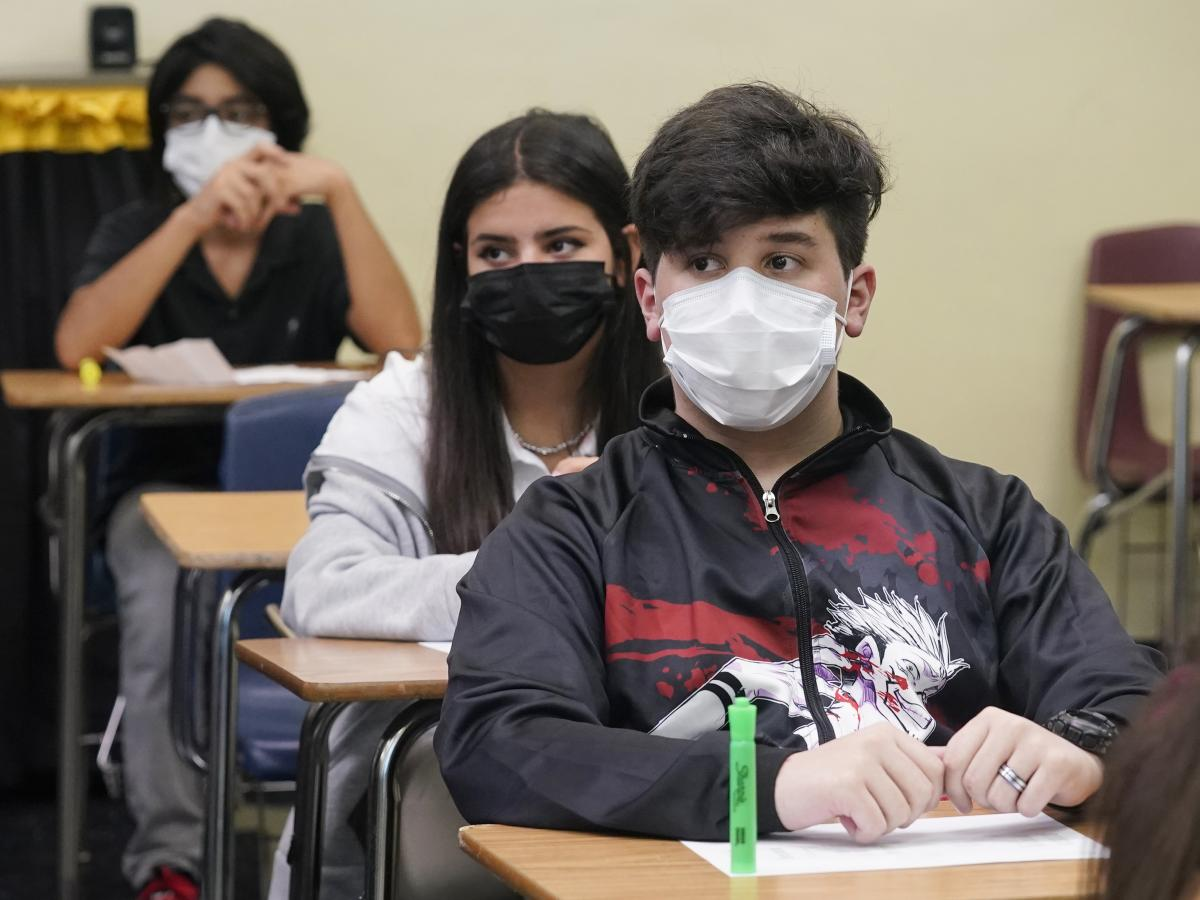 Students sit in an algebra class at Barbara Coleman Senior High School on the first day of school on Monday in Miami Lakes, Fla. Miami-Dade County public schools require students to wear a mask to prevent the spread of COVID-19.