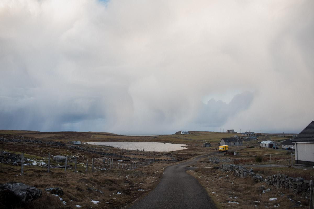The mobile library travels on one of its routes on the Outer Hebrides island of Lewis and Harris. For isolated residents, seeing the mobile librarian is sometimes the only human contact they may have for days.
