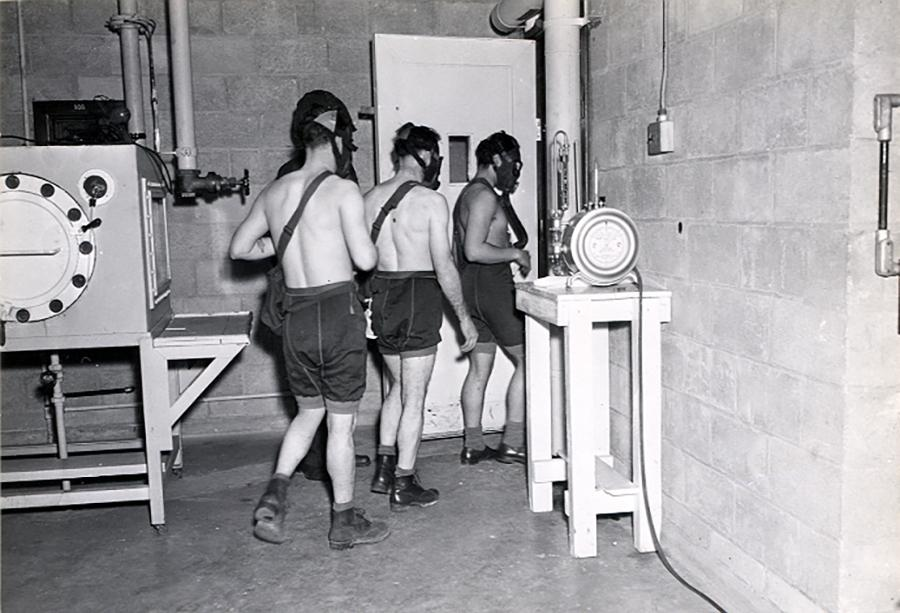 In this 1945 image, test subjects enter a gas chamber for a U.S. military experiment that will expose them to mustard gas.