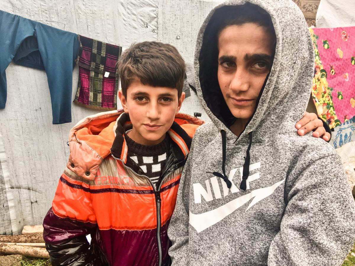 Mazen (right), 13, and his brother Mezban in a camp for displaced Yazidis in the Kurdistan region of Iraq. Mazen was freed recently, five years after being kidnapped by ISIS. He was found in Baghouz, the last ISIS stronghold in Syria. His brother was also