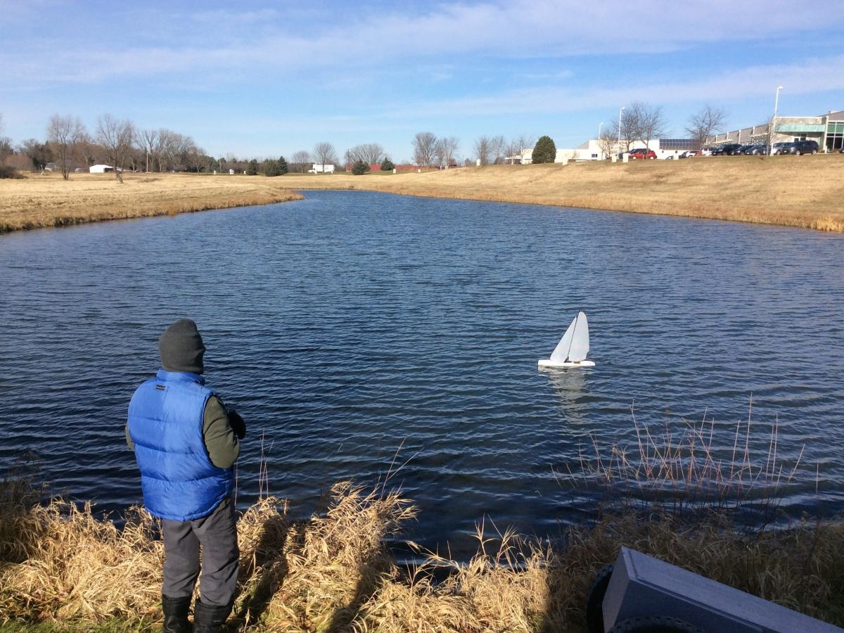 Thomas Germanson sails a radio-controlled model yacht in early December in Madison, Wis.