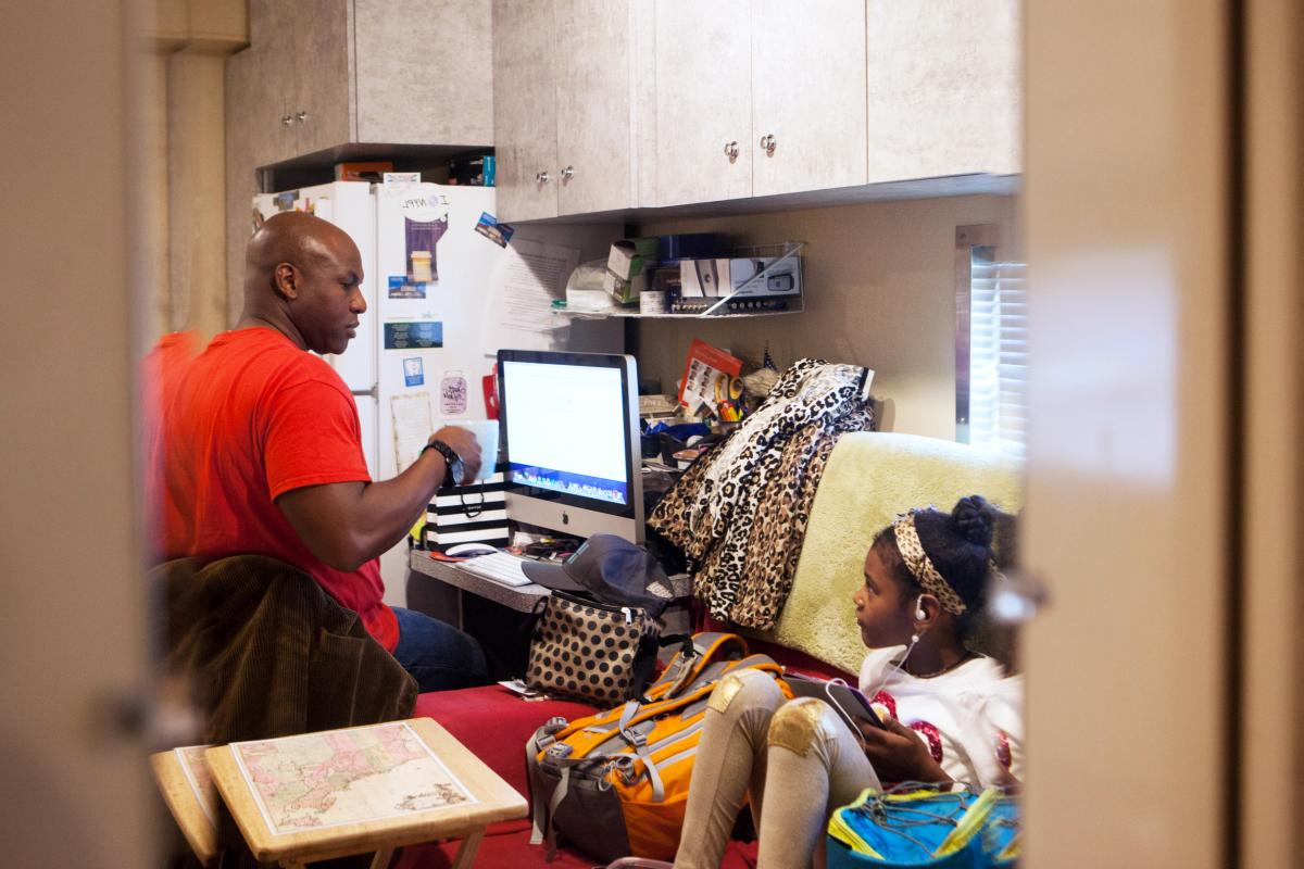 Iverson talks with his daughter, 8-year-old Lila Simone, in their home on the circus train. She and her brother, 12-year-old Matthew Felipe, have grown up in the circus and both now perform in the ring.