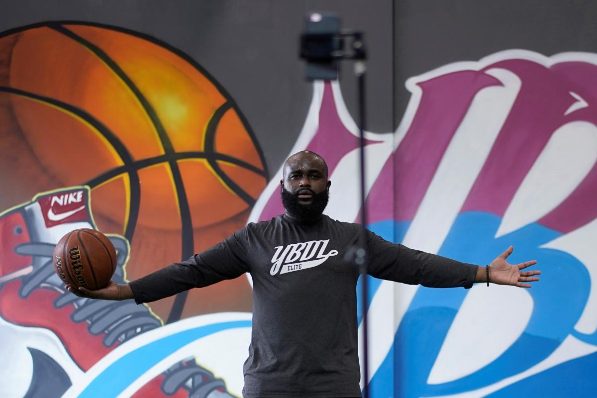 Coach Elie Rwirangira conducts a basketball lesson through a live-streaming session at YBDL Campus in Shanghai, China on March 12. Many people and companies are providing free online classes to stay fit.