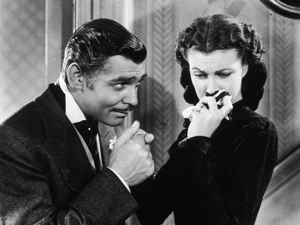 American actor Clark Gable in his role as Rhett Butler kissing the hand of a tearful Scarlett O'Hara, played by Vivien Leigh in 'Gone With The Wind'.