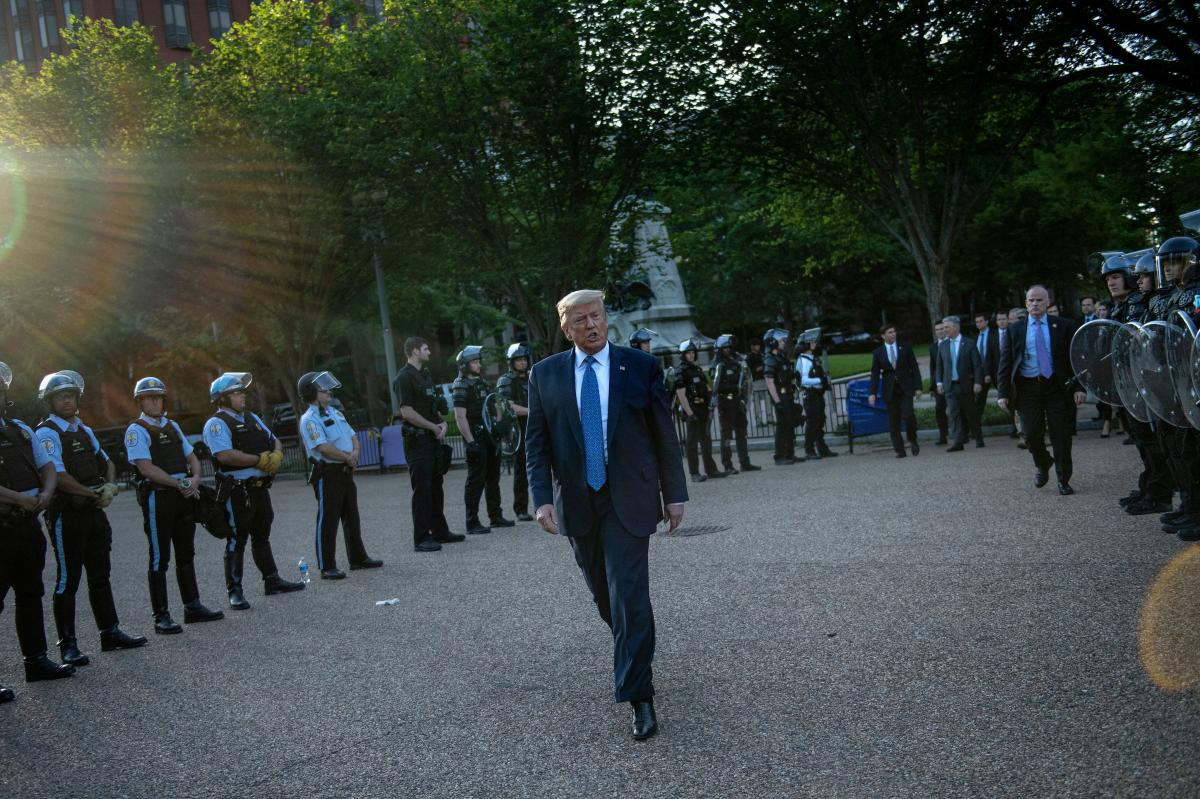 US President Trump leaves the White House on foot to go to St John's Episcopal church across Lafayette Park in Washington, D.C. Monday.