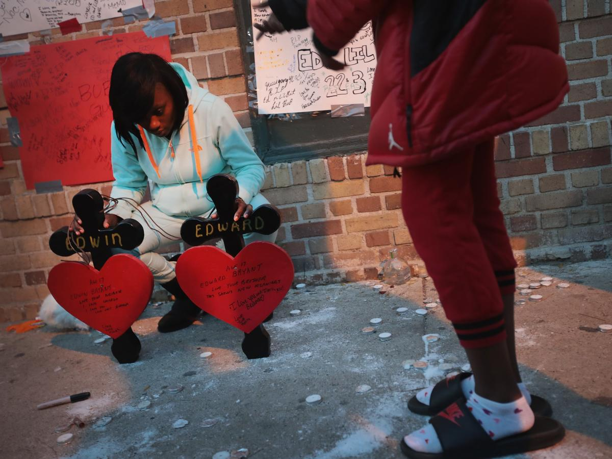Friends and family members attend a memorial service for 17-year-old twin brothers Edward and Edwin Bryant who were shot and killed in October. Chicago has logged more than 700 homicides this year, more than any other major U.S. City
