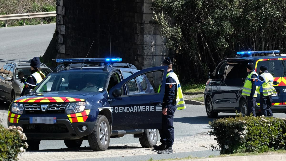French gendarmes block a road to the town of Trebes, where a man took hostages at a supermarket on Friday in southern France. At least two people were killed in the siege.
