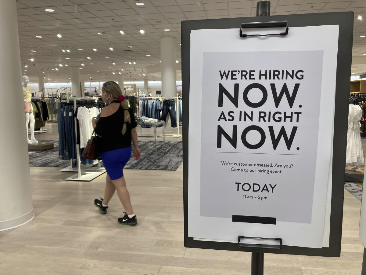 A Nordstrom store is looking for employees last month in Coral Gables, Fla. Citing a severe shortage of workers, half of the nation's governors have decided to end extra federal jobless benefits months early.
