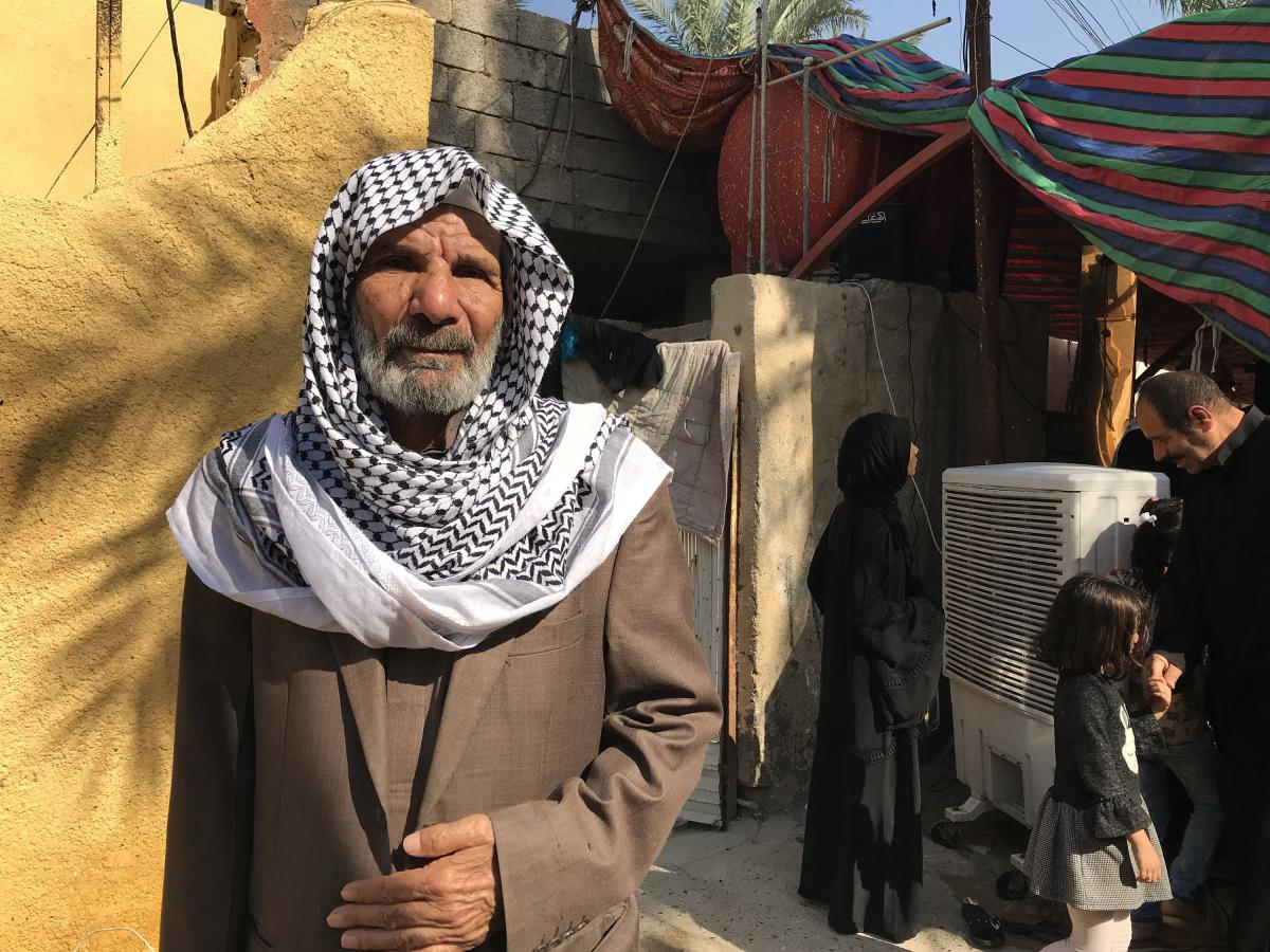 """Khazaal Salih mourns his son, Abbas Salih, a medic who was shot and killed while he was treating a wounded protester in Baghdad. """"By God, my son did nothing wrong,"""" says Salih."""