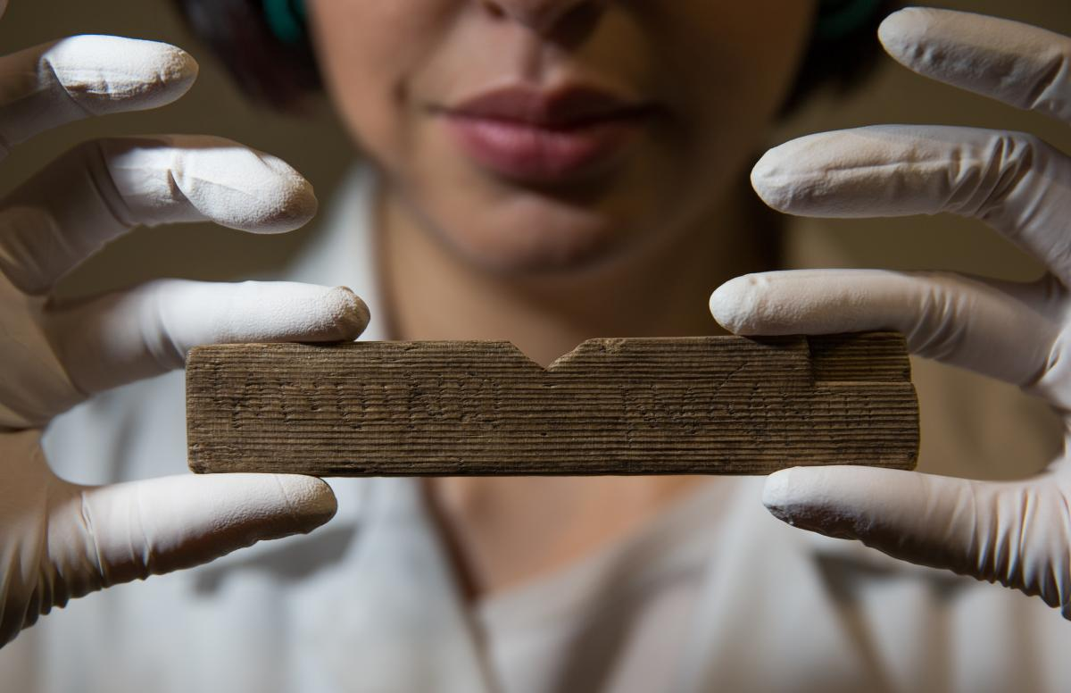"Archaeological conservator Luisa Duarte holds a Roman waxed writing tablet at Bloomberg's London offices on Wednesday. This tablet contains the earliest written reference to London, dated A.D. 65-80; it reads ""Londinio Mogontio"" --€"" that is, ""in London"