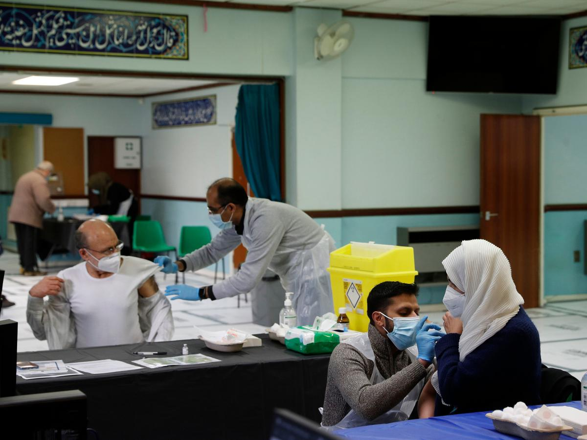 People receive the AstraZeneca COVID-19 vaccine at the Al-Abbas Islamic Center, converted into a vaccination clinic in Birmingham, England, in January. Sheikh Nuru Mohammed, the imam at the mosque, recognized many of his congregants were hesitant to get t