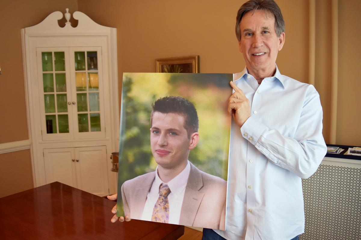 Dr. James Baker holds a photo of his son, Max, who had been sober for more than a year and was in college when he relapsed after surgery and died of a heroin overdose.