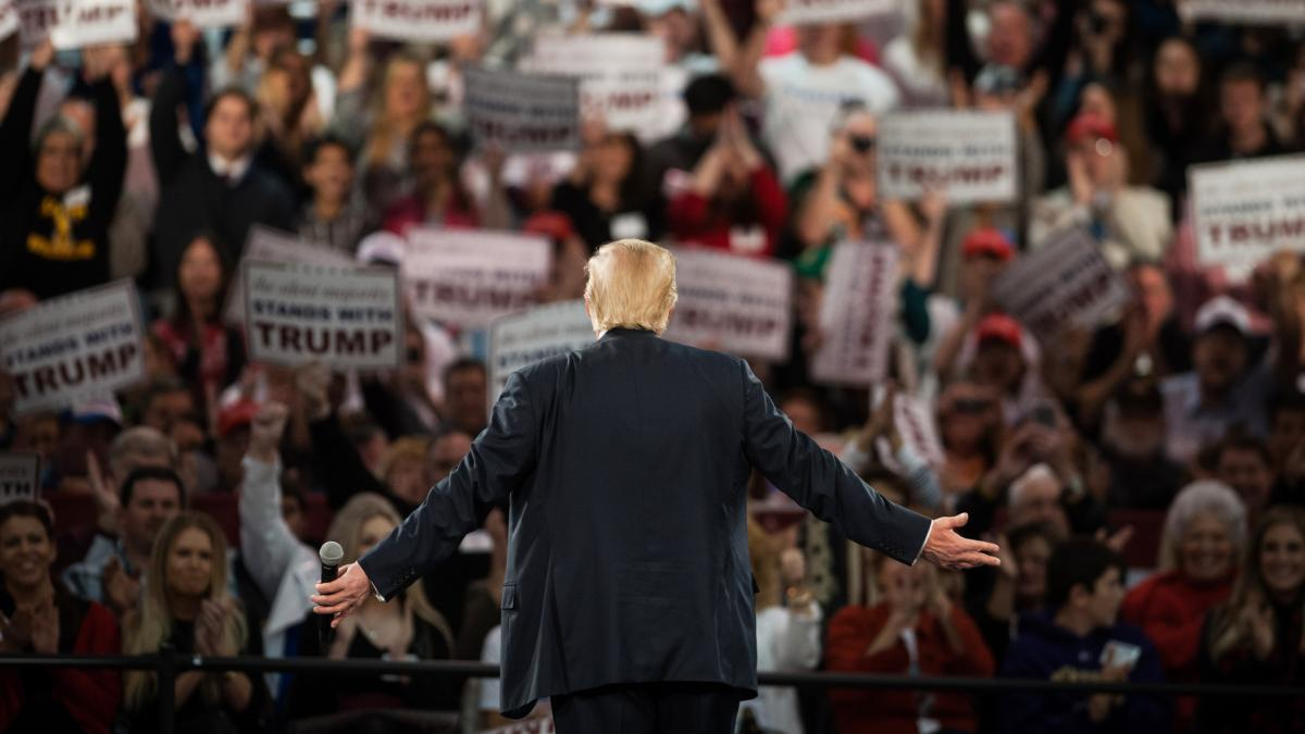 "Donald Trump listens to the crowd cheer during a campaign event in Des Moines, Iowa, on Friday. Given Trump's recent comments, media organizations have had to grapple with how to cover his campaign --€"" and many have reached different conclusions."