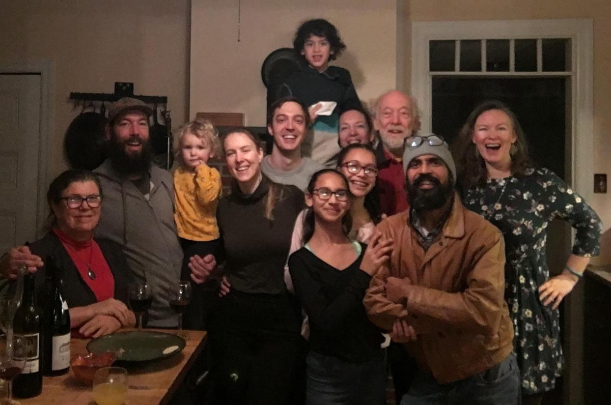 Jasmine Surti (far right) and three generations of her family celebrating Thanksgiving in Philadelphia in 2018. From left, front: Louise Aucott, Gabe Aucott with Juniper Chamberlin, Rachel Aucott, Sandhya Surti, Anjali Surti, Hemant Surti, Jasmine Surti 2