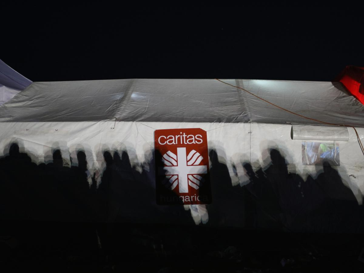 The Catholic aid organization Caritas set up a tent to provide medical care, food and clothing to migrants and refugees at the Hungarian border with Serbia. But elsewhere in Hungary, church leaders have been hesitant to help.