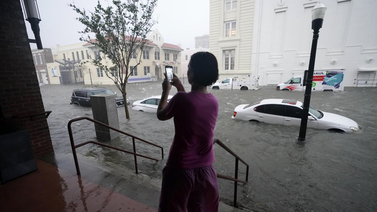 Floodwaters swamp cars on a street in downtown Pensacola, Fla., on Wednesday. Hurricane Sally made landfall near Gulf Shores, Ala., as a Category 2 storm, pushing a surge of ocean water and dumping torrential rainfall.