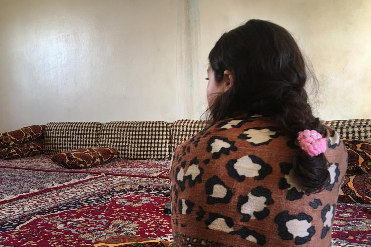 "Jeelan, 11, the day after being rescued from an ISIS family who had held her captive for the past two years. She says she doesn't remember her Yazidi family. ""I want to go back to Um Ali,"" she says, referring to the Iraqi woman who had been pretending to"
