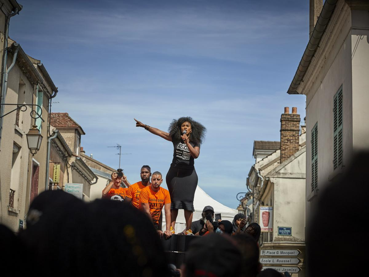 """Assa Traoré addresses a crowd during a demonstration in Persan, France, to commemorate the fourth anniversary of her brother Adama Traoré's death. """"The fight for justice for Adama belongs to all of France,"""" she says."""