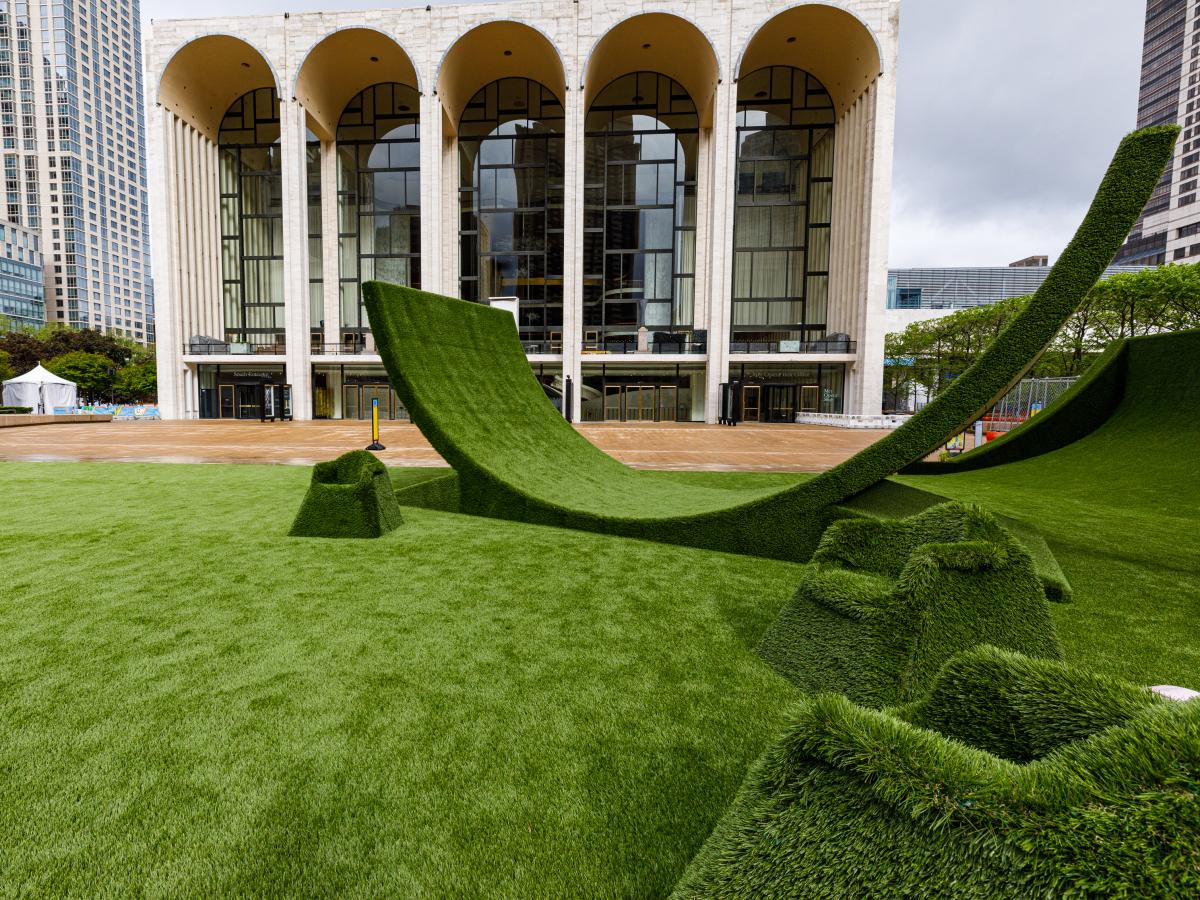 The Lincoln Center campus, presently adorned in a green carpet of synthetic grass, hosts a Juneteenth experience June 19.