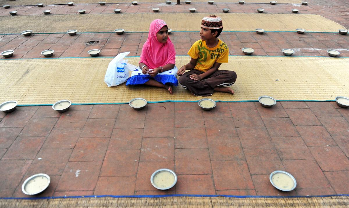 Young Indian children sit with bowls of porridge (nombu kanji) as they prepare to break the fast with the Iftar meal during the Islamic month of Ramadan at The Wallajah Big Mosque in Chennai last July.