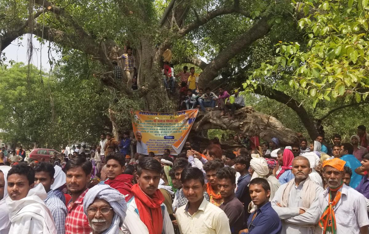 Villagers attend a campaign rally for India's ruling Bharatiya Janata Party in Ghazipur, in the northern state of Uttar Pradesh.