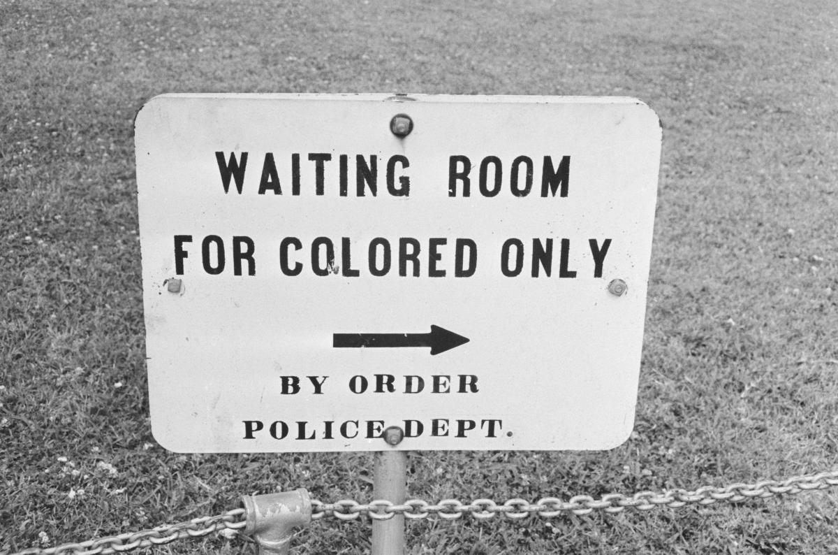 In her new book, Caste, Pulitzer Prize-winning journalist Isabel Wilkerson examines the laws and practices that created what she describes as a bipolar, Black and white caste system in the United States. Above, a sign in Jackson, Miss., in May 1961.