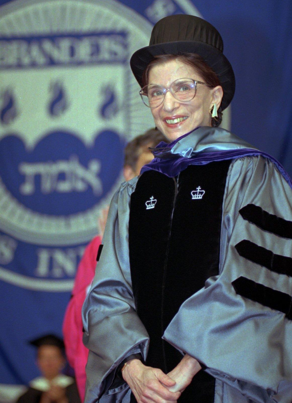 Ginsburg acknowledges applause at the 45th commencement at Brandeis University, where she received an honorary law degree in May 1996.