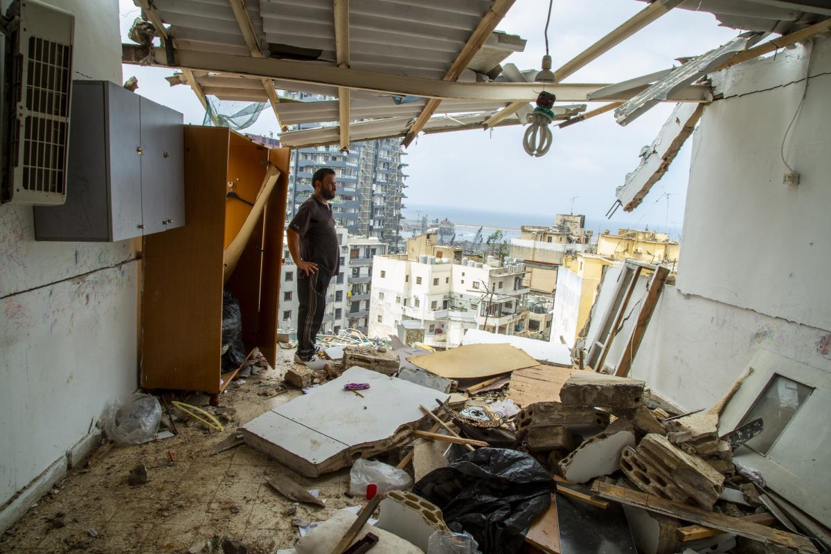 Habeb al-Hamad Azab, a Syrian refugee, stands in front of his destroyed home in Beirut's Mar Mikhael neighborhood.