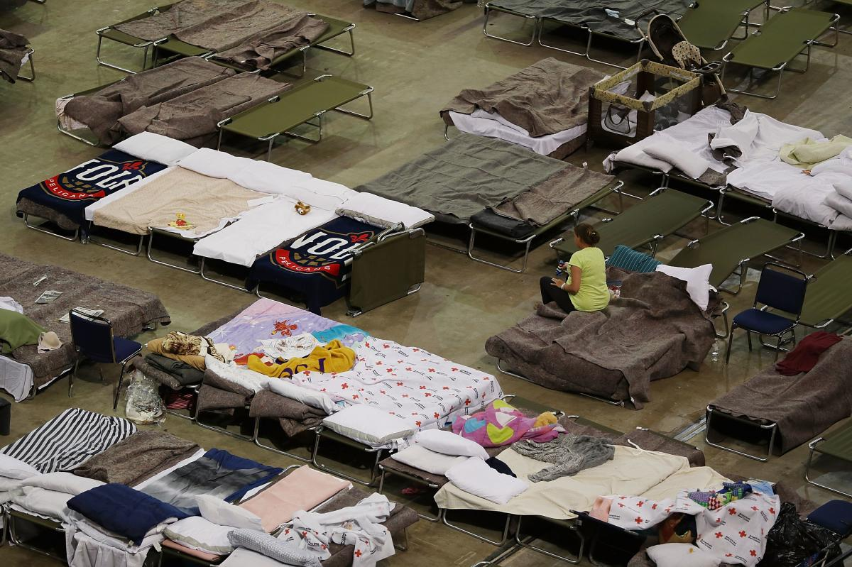 Evacuees sleep in cots on Aug. 19 at the shelter set up at the River Center arena in Baton Rouge, La., as the area deals with the record flooding.
