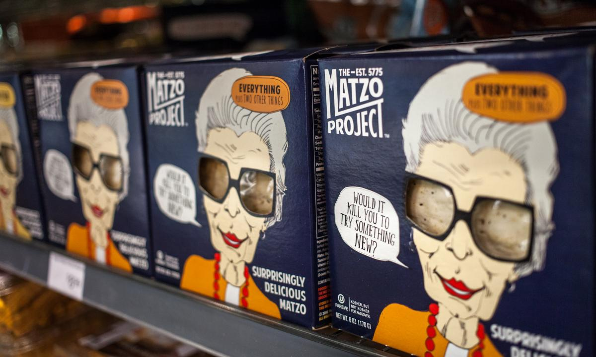 "Boxes of ""Surprisingly Delicious Matzo"" made by The Matzo Project line the shelves of Glen's Garden Market in Washington, D.C."