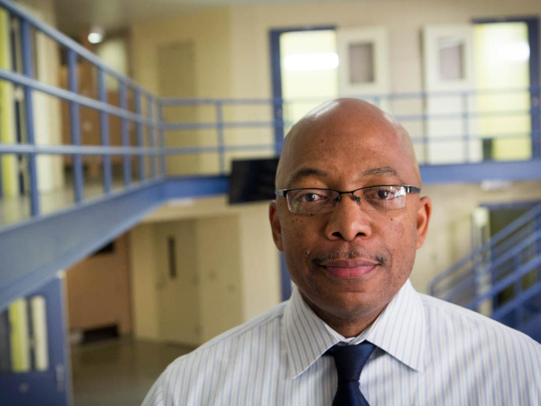 Brian Hopson, assistant superintendent at Alameda County Juvenile Hall, stands in one of its many empty units. The 360-bed facility was full when it opened eight years ago, but is now at half capacity.
